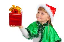 Free The Girl In A Xmas Suit With A Gift Royalty Free Stock Image - 16692286