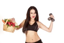 Free Woman Holding Vegetables And Weights Up Stock Image - 16693901