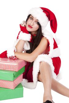 Mrs Santa Leaning On Gifts Royalty Free Stock Photo