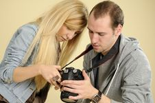 Photographer Studying On Camera Stock Images