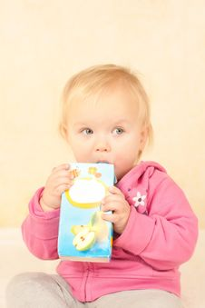 Free Cute Toddler Girl Sit And Drinking Juice Royalty Free Stock Photos - 16698968