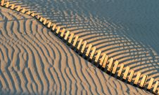 Free Fence And Shadows On Beach Stock Photos - 16699893