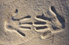 Two Handprints In The Sand Royalty Free Stock Photos