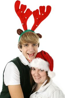 Free Adorable Teen Couple In Christmas Hats. Royalty Free Stock Images - 1677579