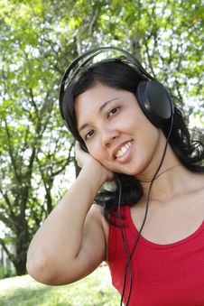 Free Woman Listening To Music Stock Image - 16701401