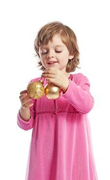 Free Little Girl Holding Golden Christmas Balls Stock Photography - 16702412