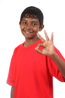 OK Signal By Young Smiling Teenager Boy In Studio Royalty Free Stock Images