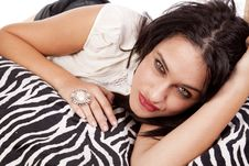 Free Woman Laying On Zebra Blanket Stock Images - 16704414
