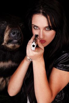 Free Woman Pointing Gun Black Bear Royalty Free Stock Photos - 16704538