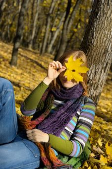 Free Woman And A Yellow Leaf Stock Image - 16704811