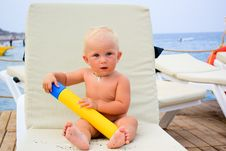 Beautiful Baby On A Beach Chair Royalty Free Stock Photography