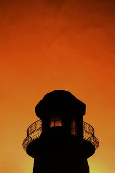 Silhouette Of A Lighthouse At Sunset Stock Image
