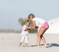 Free Mother And Son Playing On Beach Stock Images - 16708614