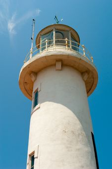Free Lighthouse Against A Blue Sky Stock Image - 16710621