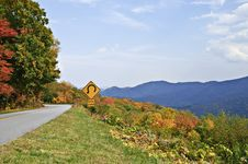 Free Sign On Mountain Highway Stock Photos - 16711543