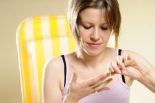 Woman Applying Moisturizer Stock Images
