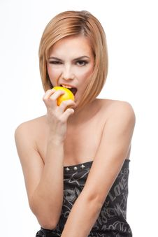 Free Young Woman Biting On A Whole Lemon Royalty Free Stock Photos - 16717888