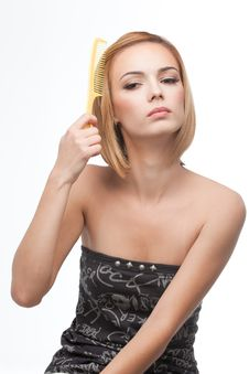 Free Young Woman Combing Her Hair Royalty Free Stock Images - 16717959