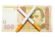 Free Cigarettes Crossed Over One Hundred Hrivna Stock Photography - 16718042