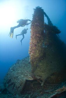 Free Scuba Divers Exploring A Shipwreck. Stock Photo - 16719050