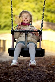 Free Little Happy Girl On The Swing Royalty Free Stock Images - 16724139
