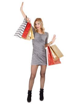 Free Sexy Blond Woman With Shopping Bags Royalty Free Stock Image - 16724306