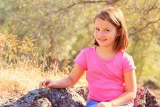 Free Young Sitting On Rocks Royalty Free Stock Images - 16724709