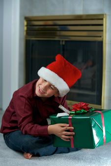Boy In Santa Hat With Gift Royalty Free Stock Photography