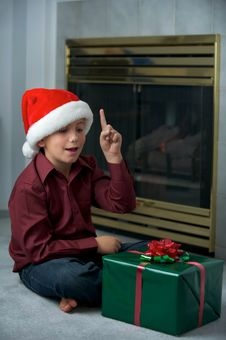 Christmas Boy And Present Royalty Free Stock Photo