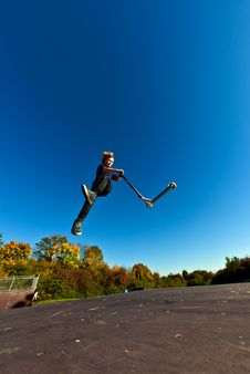 Free Young Boy Going Airborne With Scooter Royalty Free Stock Photo - 16725025