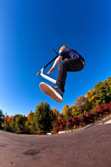 Free Young Boy Going Airborne With Scooter Stock Image - 16725041