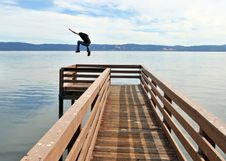 Free Jumping Off A Pier Into The Ocean Stock Images - 16725044