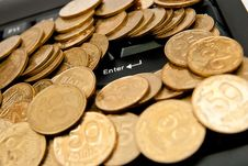 Free Coins On Keyboard Royalty Free Stock Photography - 16726457