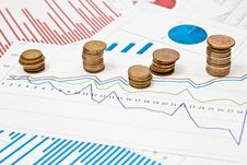 Free Coins And Charts Stock Photos - 16726463