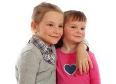 Free Two Young Sisters Posing Together In A Studio Stock Photos - 16727653