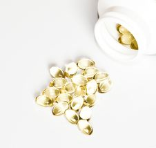Free Yellow Pills And A Package Of Pills Isolated Stock Photography - 16729932