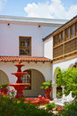 Free Spanish Style Patio With Red Fountain Royalty Free Stock Images - 16735679