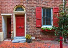 Free Colorful Red Door And Brick Wall Stock Photography - 16735282