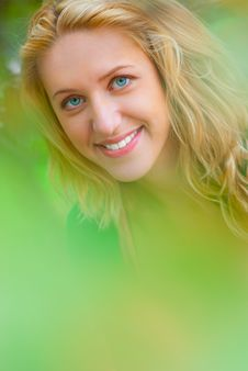 Free Portrait Of Young Blonde Through Foliage. Royalty Free Stock Photos - 16740868