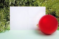Postcard With New Year Ball And Fir-tree Royalty Free Stock Photography