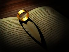 Free Gold Ring Casts Shadow Of A Heart Stock Image - 16742541