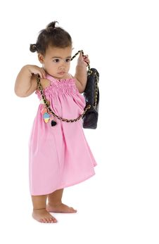 Free Cute Little Girl With Purse Royalty Free Stock Photo - 16743485