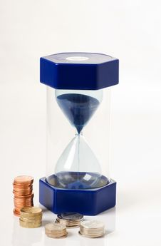 Free Hourglass And Money Royalty Free Stock Image - 16746836