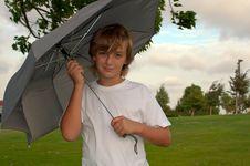 Boy With An Umbrella . Stock Photography