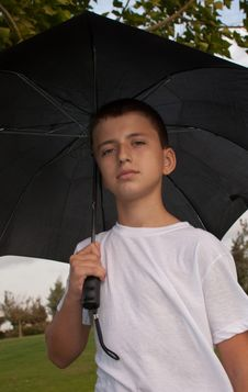 Boy With An Umbrella . Royalty Free Stock Photography