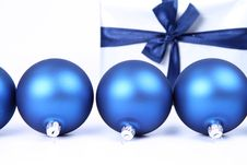 Free Christmas Balls And A Gift Background Royalty Free Stock Images - 16747709