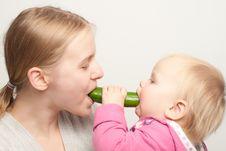 Mother With Daughter Eat Cucumber Stock Photos