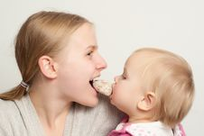 Mother With Daughter Eat Gingerbread Royalty Free Stock Photo
