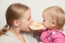 Free Mother With Daughter Eat And Bitting Flatbread Stock Photos - 16748323