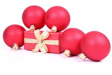 Christmas Balls And A Gift Royalty Free Stock Photography